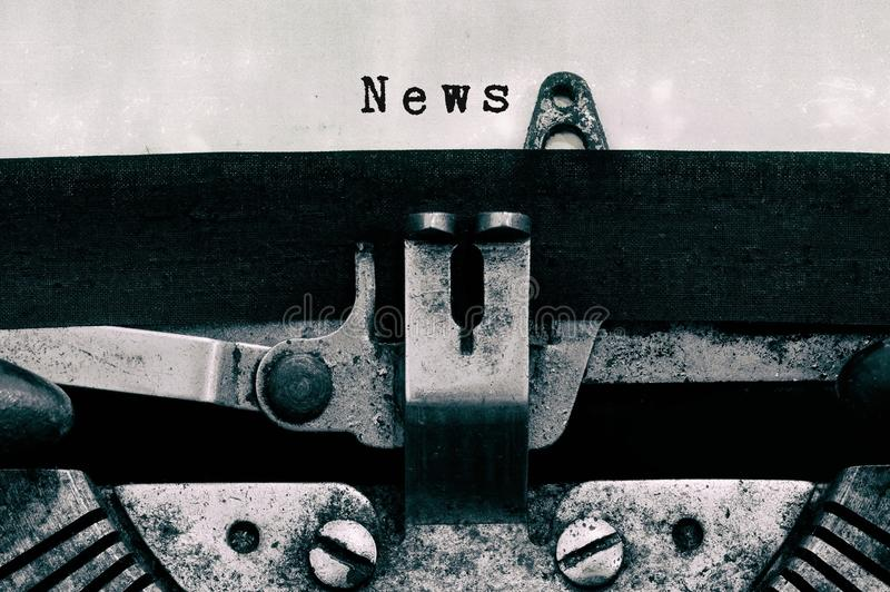 News words typed on a vintage typewriter stock image