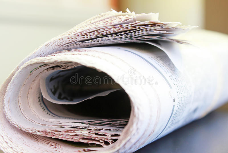 Newspaper. Abstract of a newspaper, rolled and focused on the edges stock photo