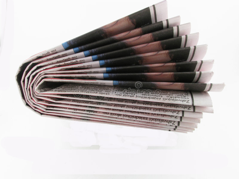 Newspaper. A stack of newspaper on white background royalty free stock photo