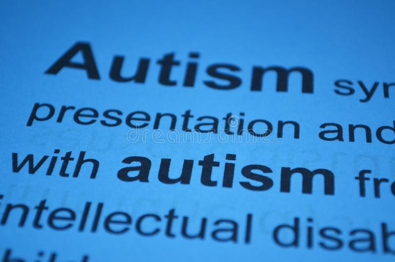 Word AUTISM , close up. Newspaper article with detailed word AUTISM, closeup stock images