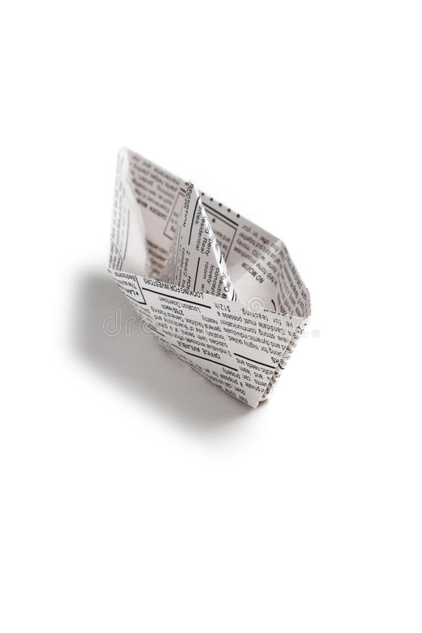 Newspaper boat. Fake Newspaper, boat, business concept royalty free stock photo