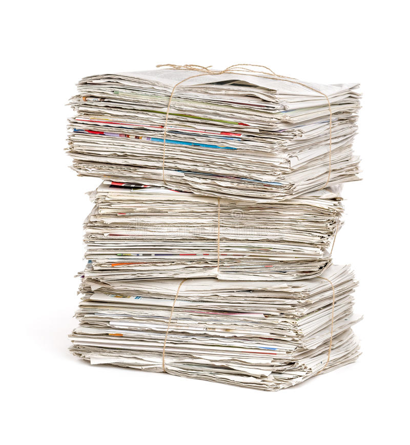 Free Newspaper Bundles On A White Background Stock Image - 55560571