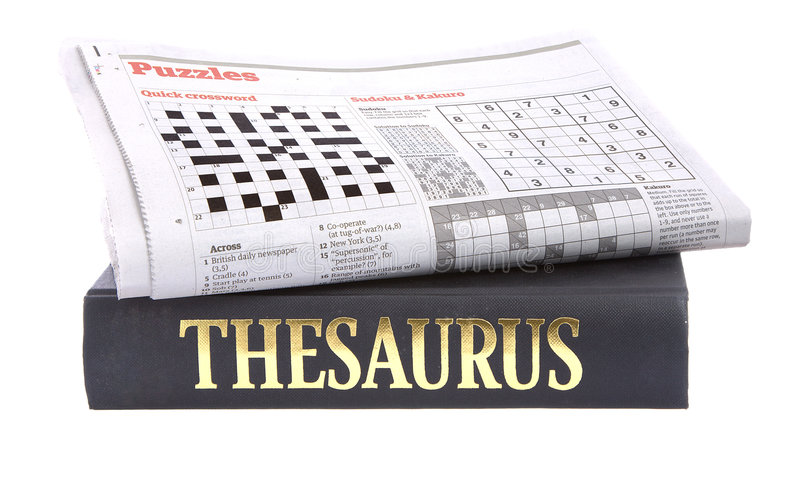 Newspaper crossword on top of a thesaurus stock photos