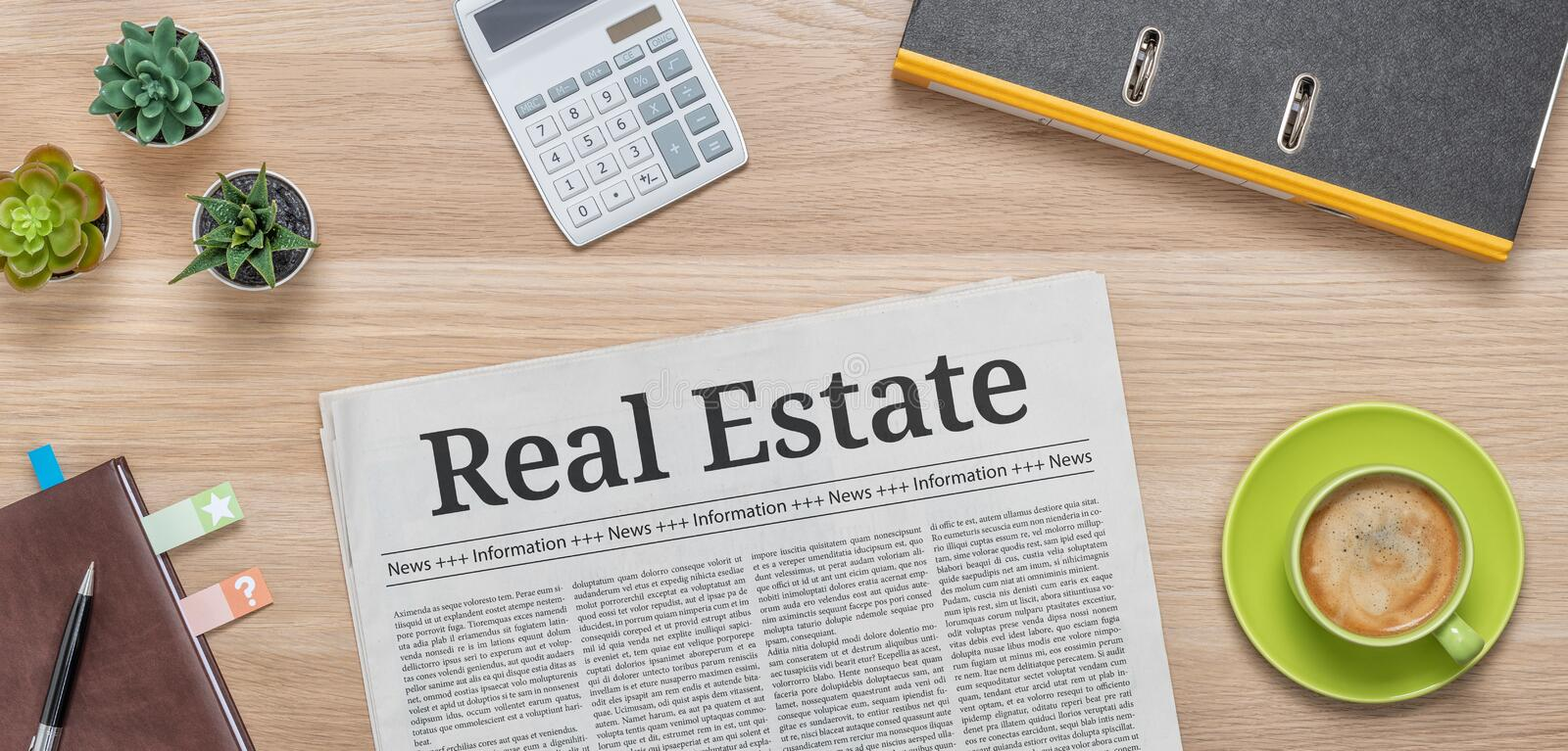 A newspaper on a desk with the headline Real Estate stock photo
