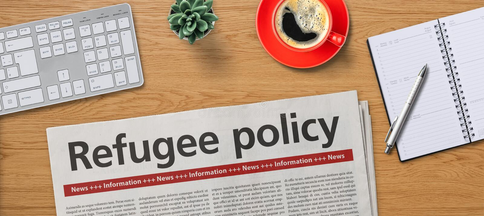 Newspaper on a desk -  Refugee policy stock images
