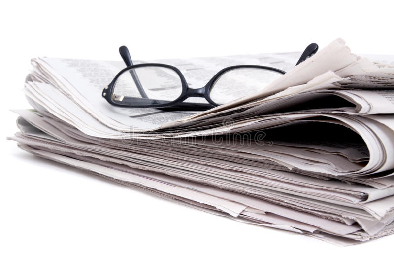 Newspaper and glasses stock photo