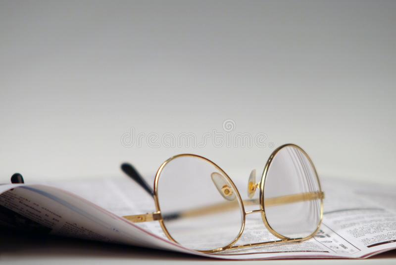 Newspaper and glasses royalty free stock photos