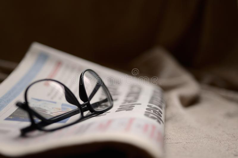 Newspaper and Glasses stock photography