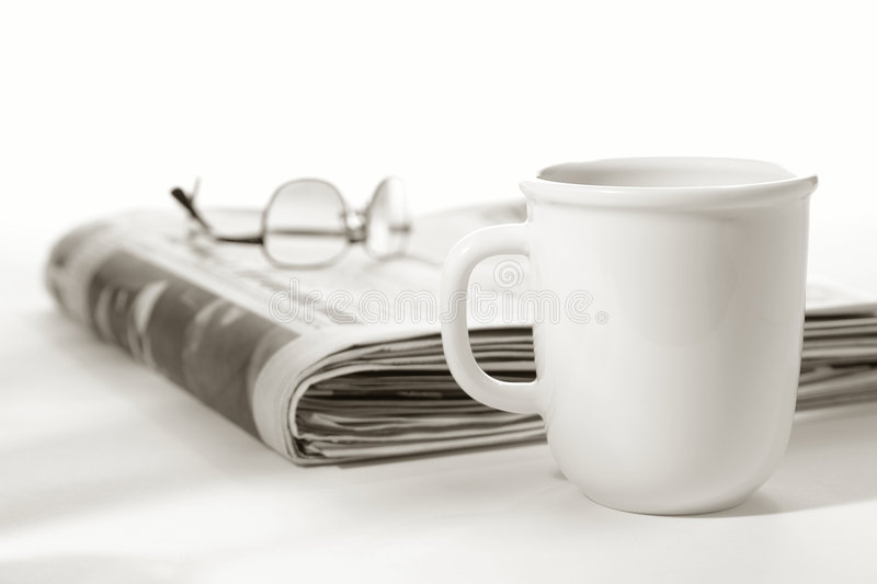 Newspaper With Glasses On Top And Cup Of Coffee Stock
