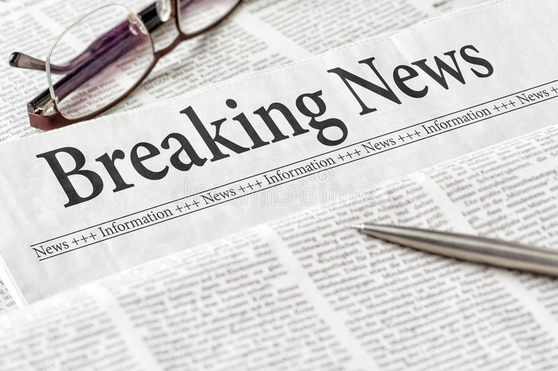 Newspaper with the headline Breaking News royalty free stock image