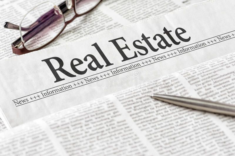 Newspaper with the headline Real Estate stock photos