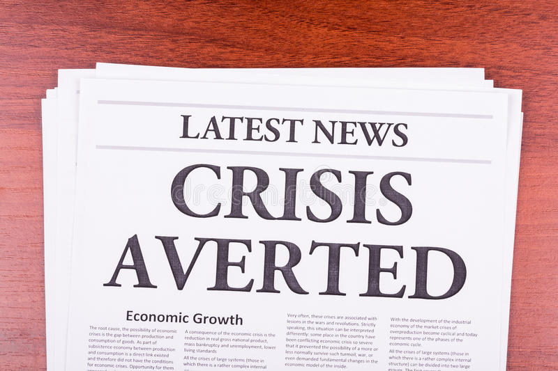 The newspaper LATEST NEWS. With the headline CRISIS AVERTED stock images