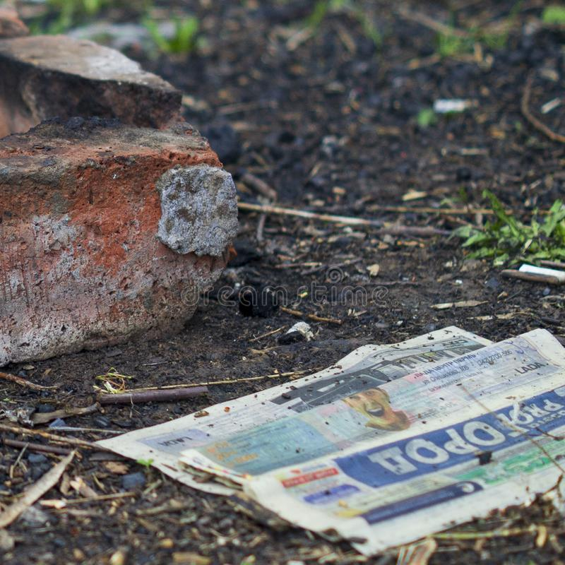 The old newspaper lies on the ground stock photography