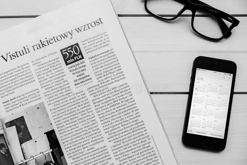 Newspaper and mobile phone stock photography