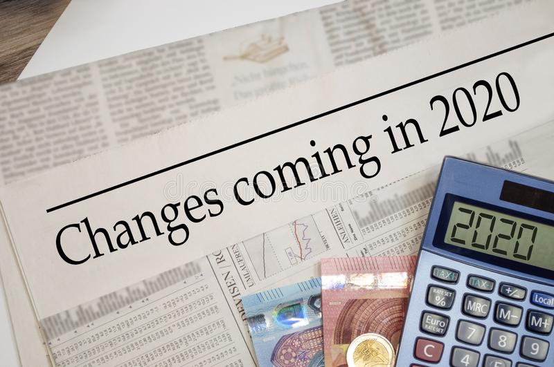 Newspaper with money and calculator and headline Changes coming in 2020. 2019 stock image