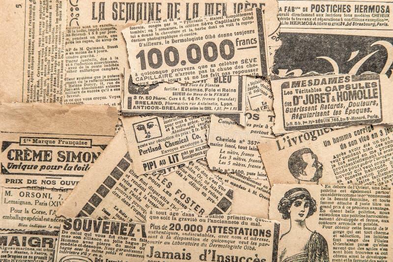 Newspaper pieces vintage advertising Old magazine strips. Newspaper pieces with vintage advertising. Old magazine strips royalty free stock photography