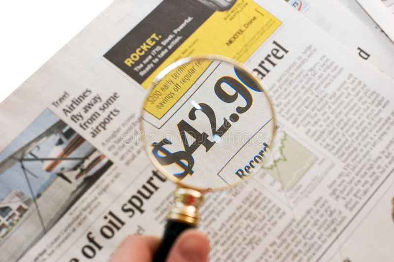 Newspaper_price_magnified_2 stock photography