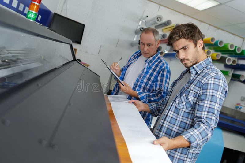 Newspaper production and printing process royalty free stock photo