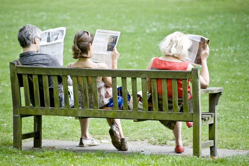 Newspaper Readers Editorial Stock Photo