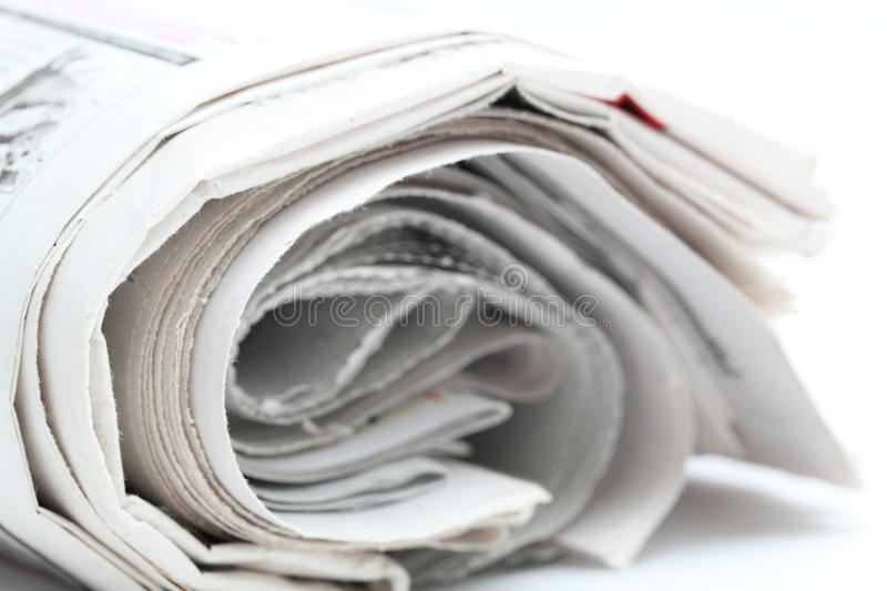Newspaper roll. Isolated on white background royalty free stock photography