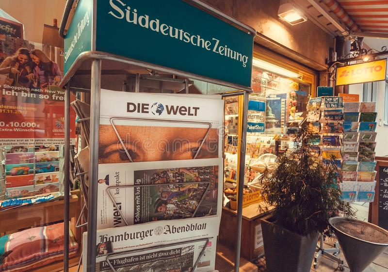 Newspaper stand with frontapage of tabloid Die Welt near street store. MUNICH, GERMANY - NOVEMBER 16, 2017: Newspaper stand with frontapage of tabloid Die Welt stock photography