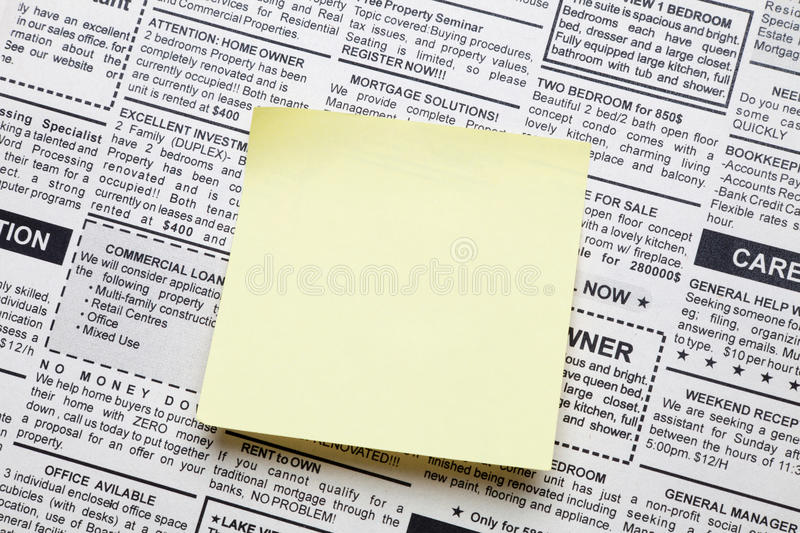 Newspaper and sticky note royalty free stock photography