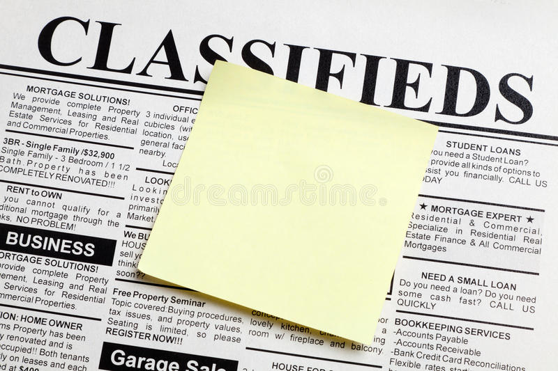Newspaper and sticky note stock photos