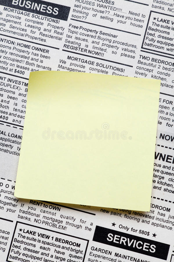 Newspaper and sticky note stock photo