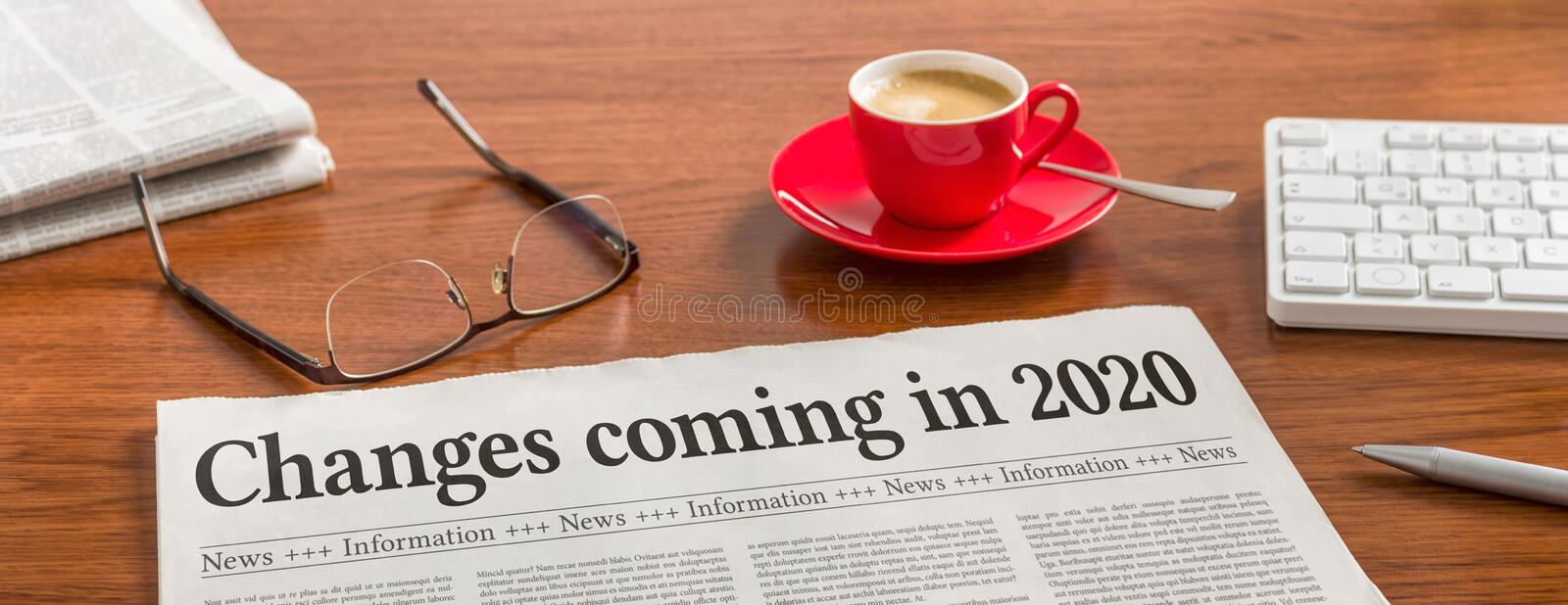 A newspaper on a wooden desk - Changes coming in 2020 stock photography