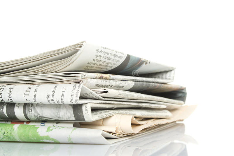 Newspapers. Eyelet newspapers. Isolated on white background royalty free stock images