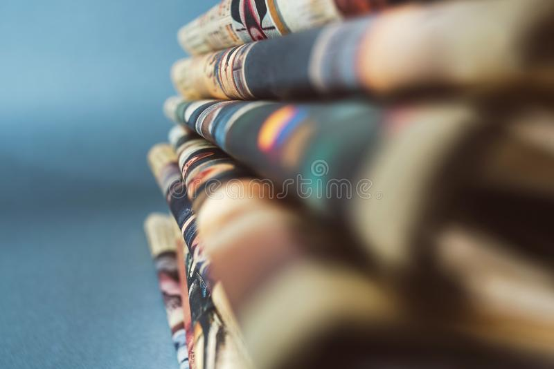 Newspapers on blue background stock photos