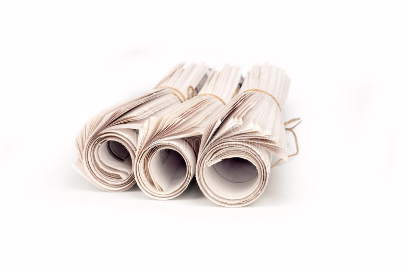 Newspapers rolled up. Isolated on white background stock illustration