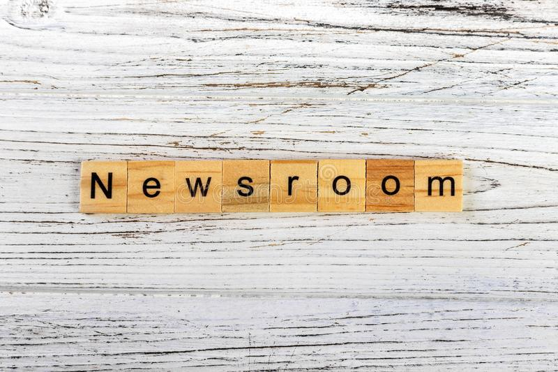 NEWSROOM word made with wooden blocks concept.  stock photography