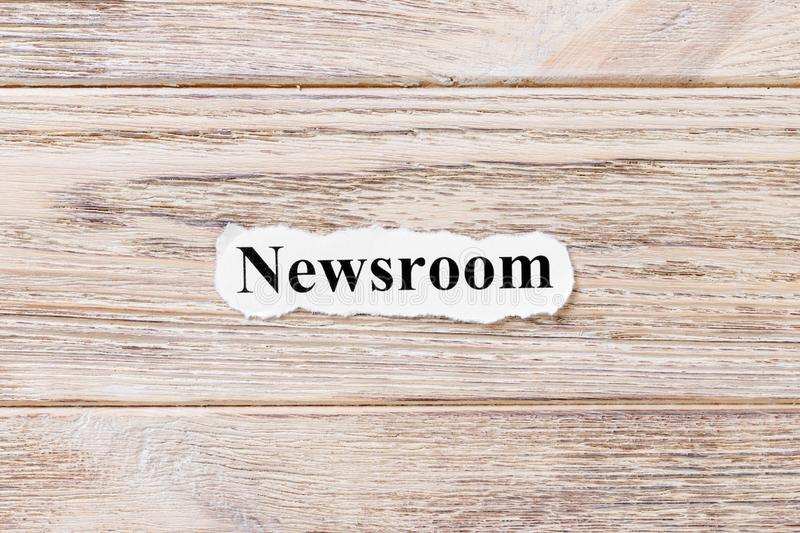 Newsroom of the word on paper. concept. Words of Newsroom on a wooden background.  stock photo