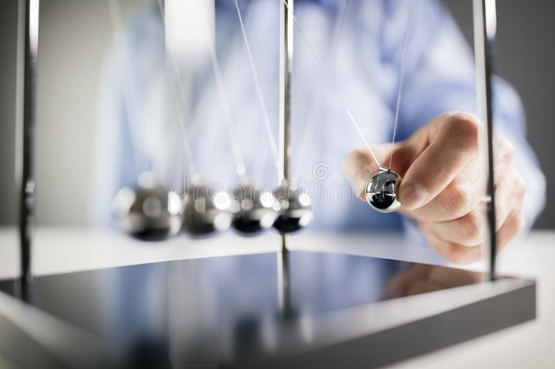 Newton`s cradle businessman concept for cause and effect stock photos