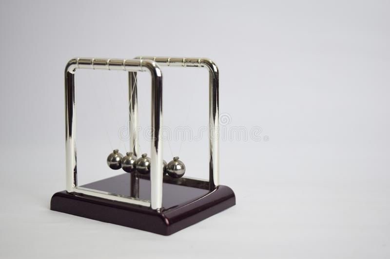 Newton`s cradle work. Education, science and physics concept isolated white background royalty free stock photo
