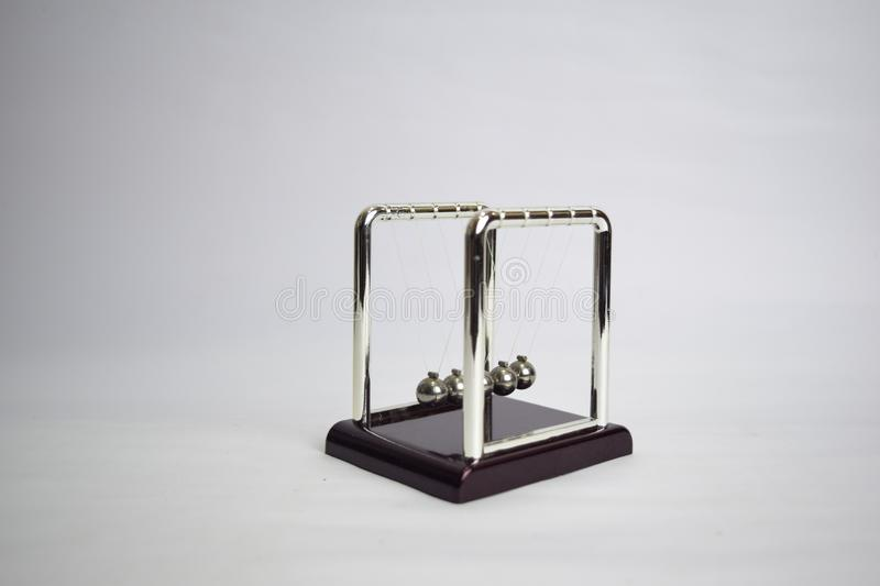 Newton`s cradle work. Education, science and physics concept isolated white background stock photo