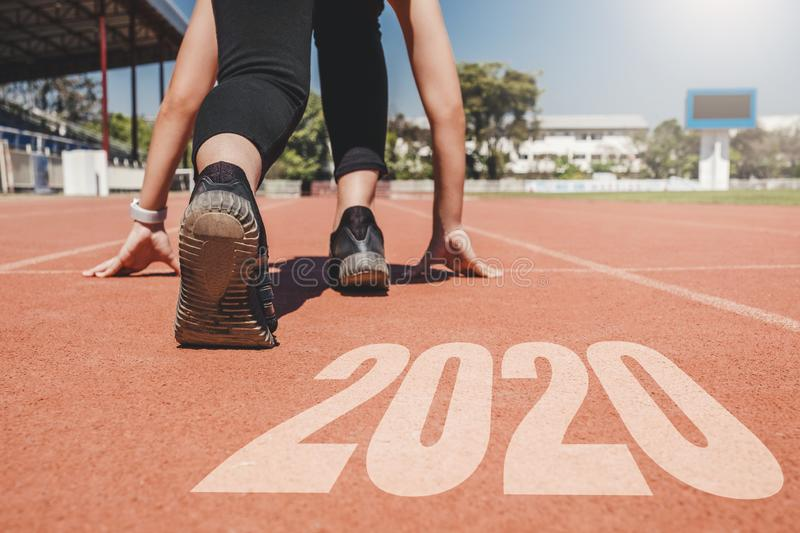 2020 Newyear , Athlete Woman starting on line for start running with number 2020 Start to new year stock photography