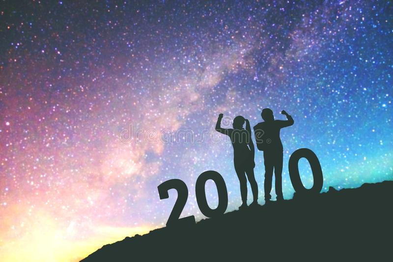 2020 Newyear  Couple celebration success of 2020 Happy new year background on  the Milky Way galaxy royalty free stock images