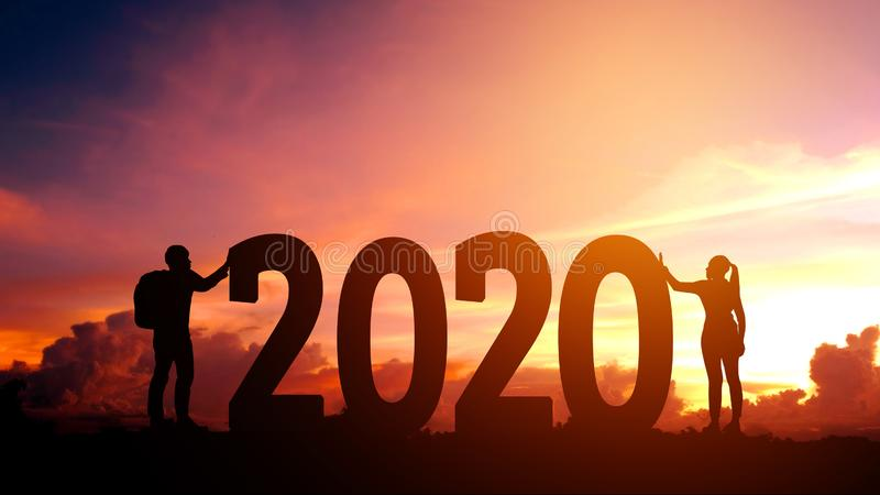 2020 Newyear  Couple tries to push number of 2020 Happy new year concept stock photography