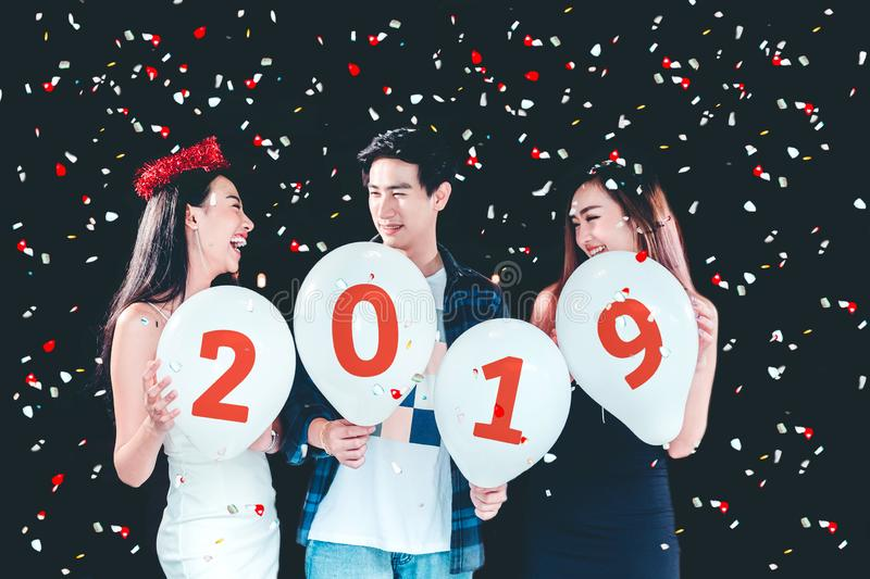Newyear party ,celebration party group of asian young people holding balloon numbers 2019 happy and funny concept royalty free stock photography