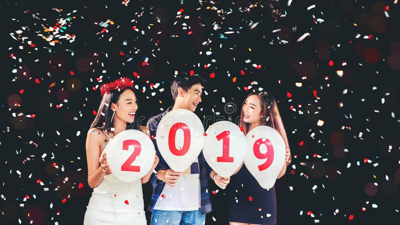 Newyear party ,celebration party group of asian young people holding balloon numbers 2019 happy and funny concept royalty free stock photos