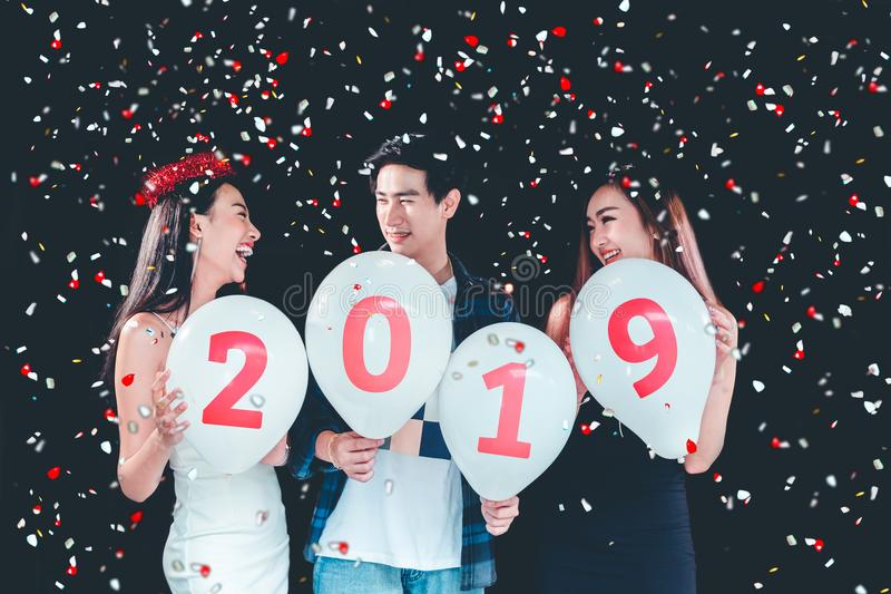 Newyear party ,celebration party group of asian young people holding balloon numbers 2019 happy and funny concept royalty free stock photo