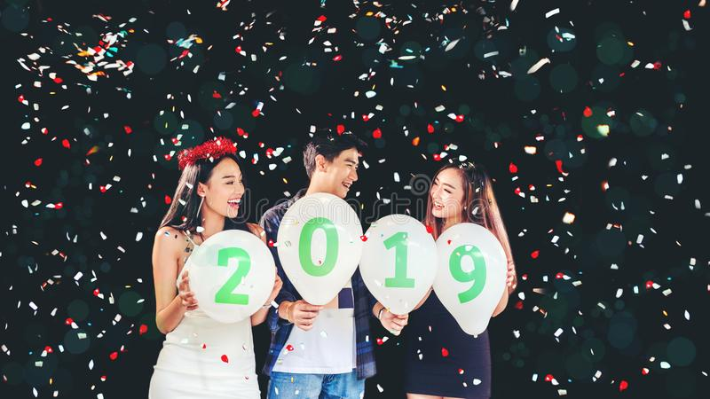 Newyear party ,celebration party group of asian young people holding balloon numbers 2019 happy and funny concept stock photos