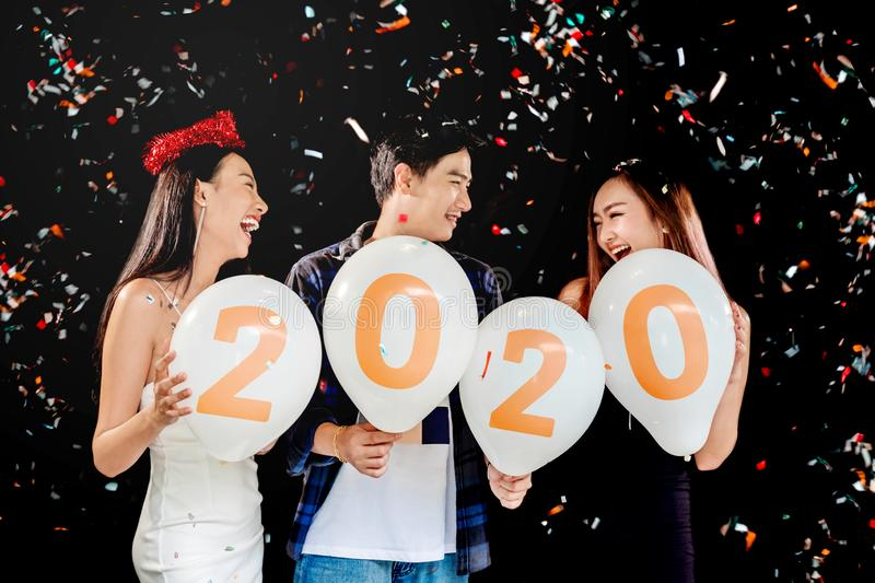 2020 Newyear party ,celebration party group of asian young people holding balloon numbers 2020 happy and funny concept stock images