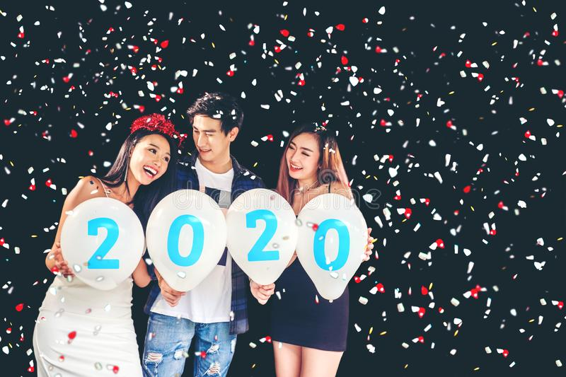 2020 Newyear party ,celebration party group of asian young people holding balloon numbers 2020 happy and funny concept stock photo
