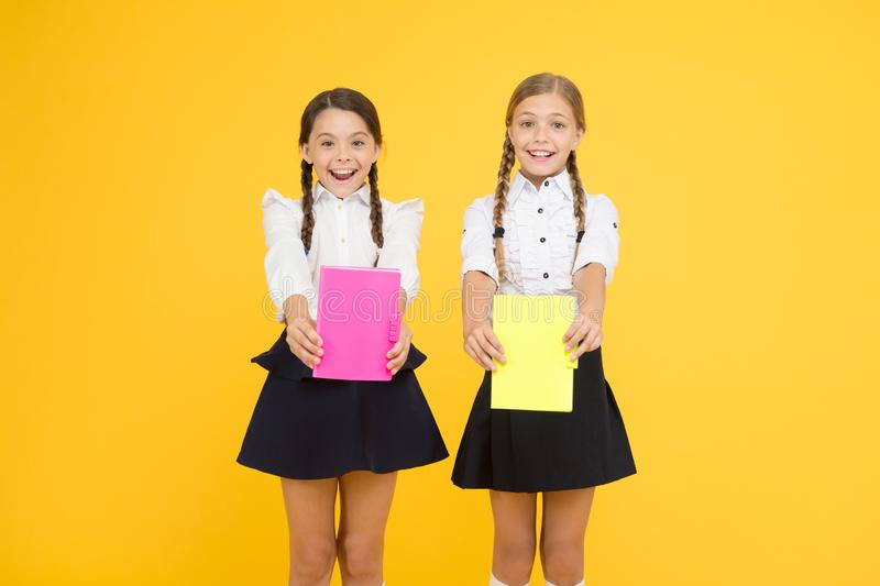 Next Chapter. kids learning grammar. back to school. reading story. childrens literature. cheerful classmates with. Workbook. dictionary notebook. Get stock photo