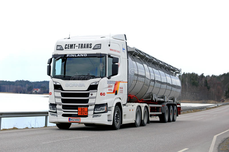 Next Generation Scania Tank Truck on Brigde. SALO, FINLAND - APRIL 14, 2017: White Next Generation Scania R500 semi tanker for ADR haul of Cemt-Trans moves along royalty free stock photography