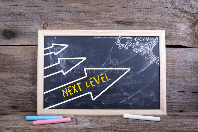 Next Level. Old wooden background with texture and chalk blackboard stock image