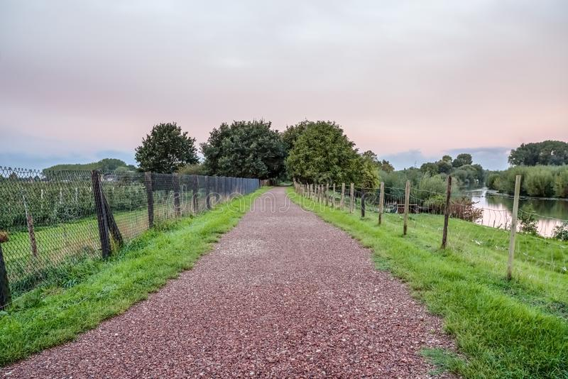 Hunting trail along the water. Next to the field of fruit trees there is a Hunting Trail along the water royalty free stock photography